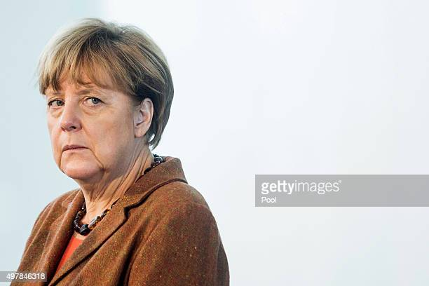 Austrian Chancellor Werner Faymann and German Chancellor Angela Merkel give a joint press conference at the German Chancellery on November 19 2015 in...