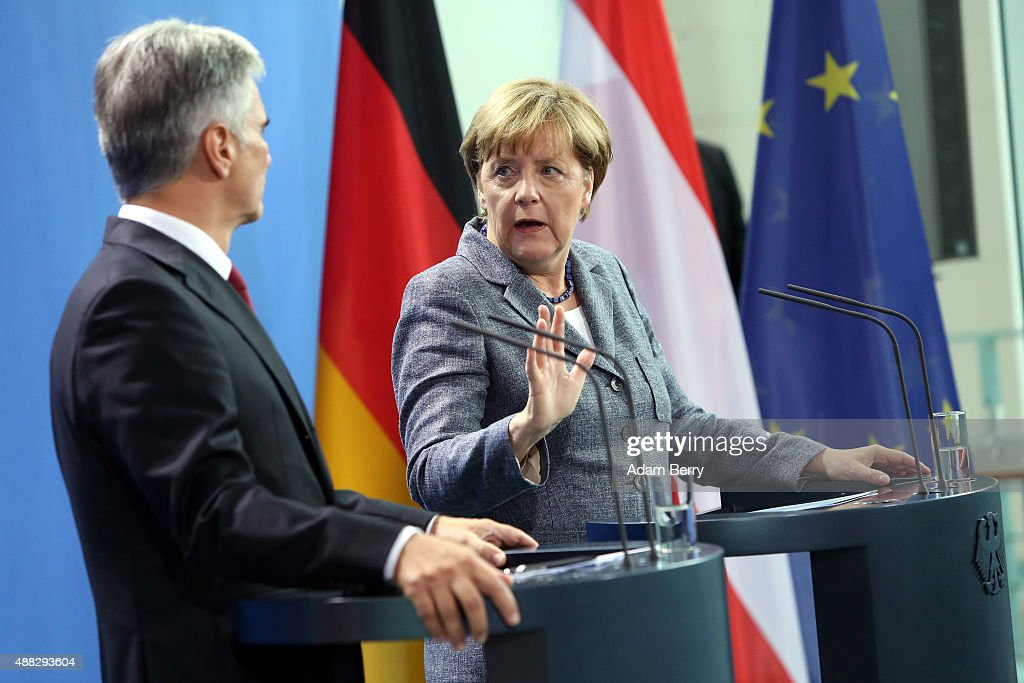 Austrian Chancellor Werner Faymann and German Chancellor Angela Merkel speak to the media after talks on the ongoing refugee crisis on September 15...