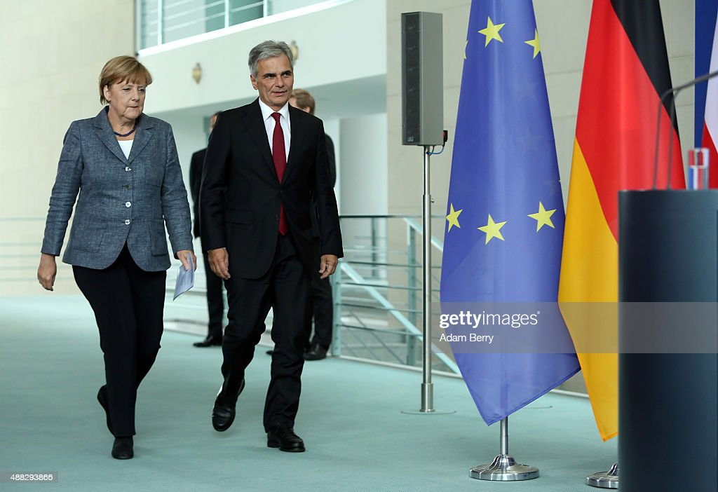 Austrian Chancellor Werner Faymann and German Chancellor Angela Merkel arrive to speak to the media after talks on the ongoing refugee crisis on...