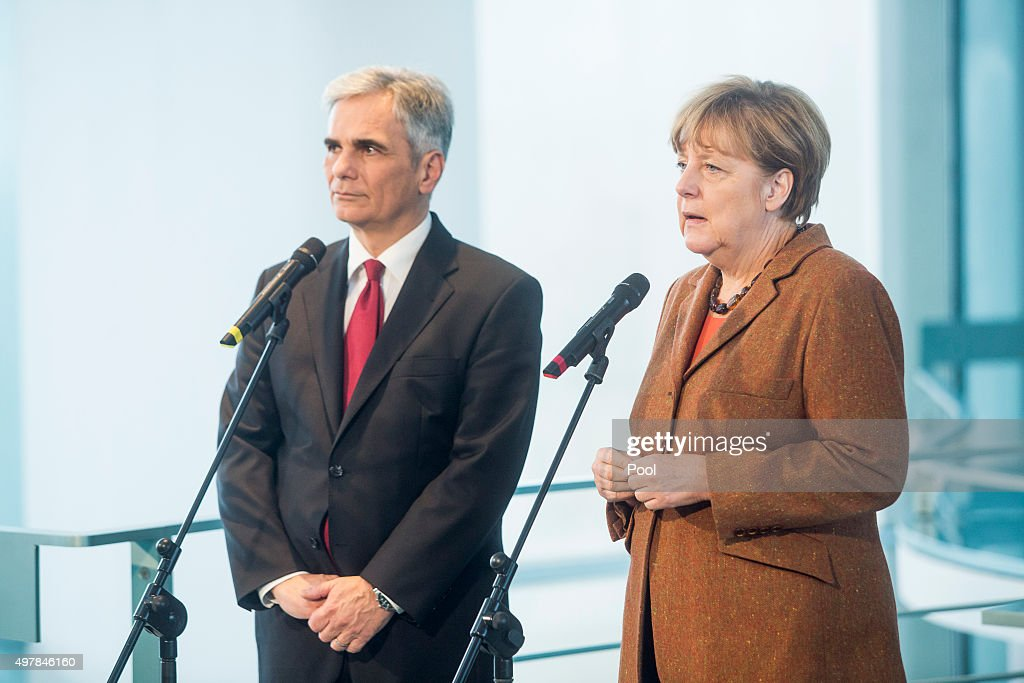 Austrian Chancellor Werner Faymann and German Chancellor Angela Merkel prepare to give a joint press conference at the German Chancellery on November 19, 2015 in in Berlin, Germany. Austrian Chancellor Faymann has called for more intensive border checks on migrants in the aftermath of the Paris attacks, as he and Chancellor Merkel also called for an increase in help amongst EU countries for the refugee crisis.
