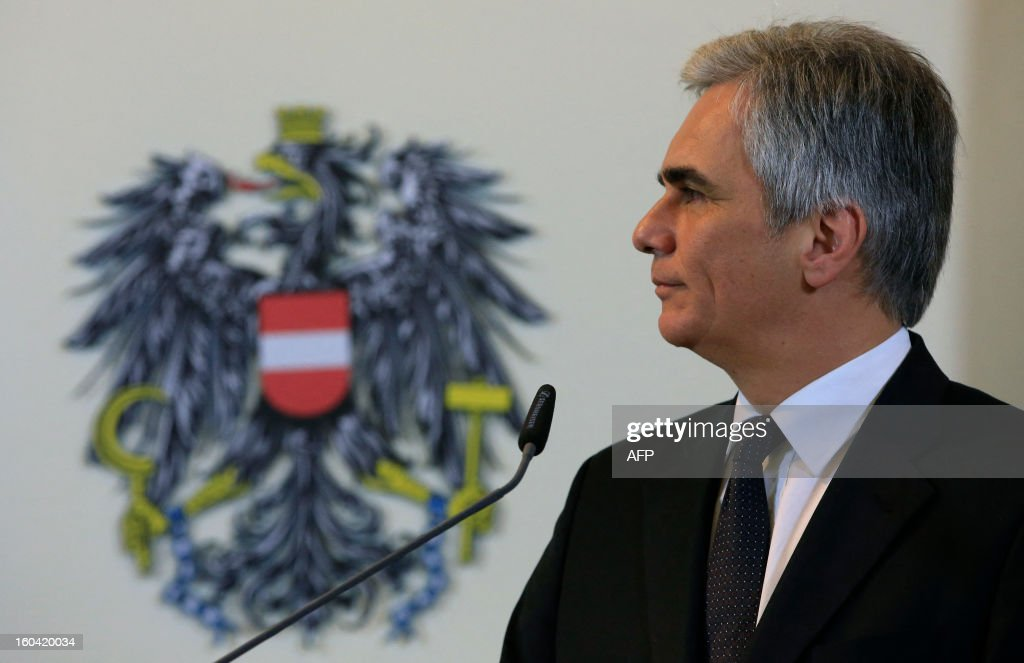 Austrian Chancellor Werner Faymann attends a joint press conference with European Commission President Barroso (not in pic) after a meeting in Vienna, Austria on January 31, 2013.