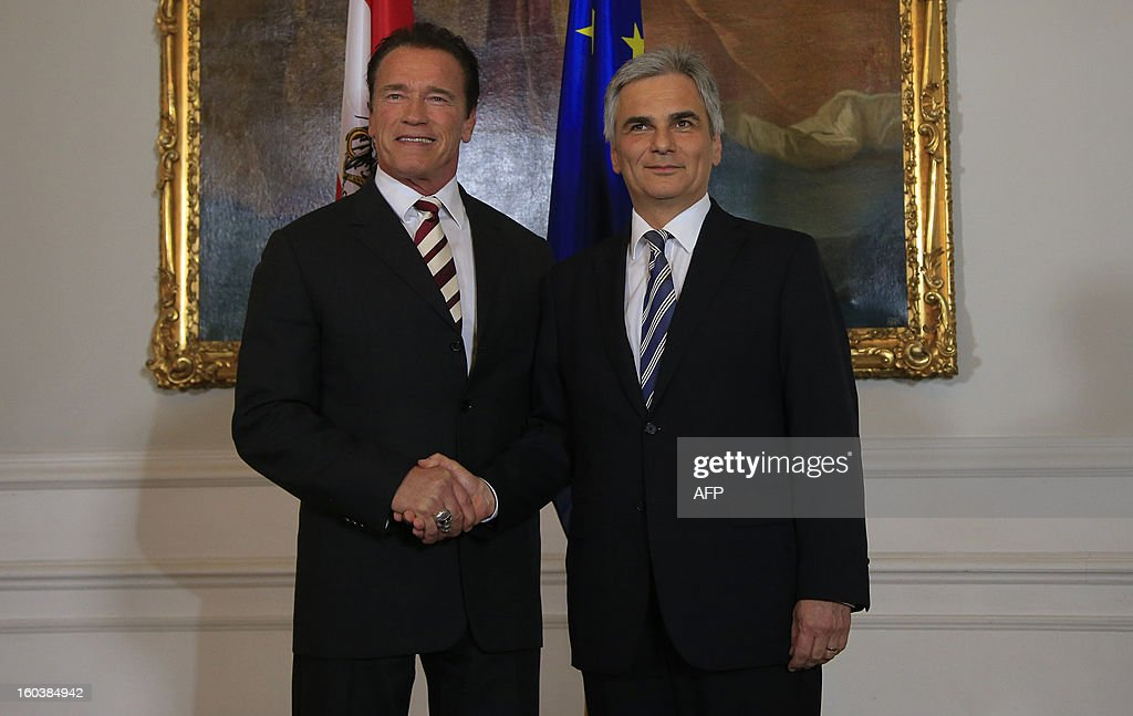 Austrian Chancellor Werner Faymann (R) poses for photographers with Austrian born actor and former governor of the state of California Arnold Schwarzenegger, in Vienna on January 30, 2013.