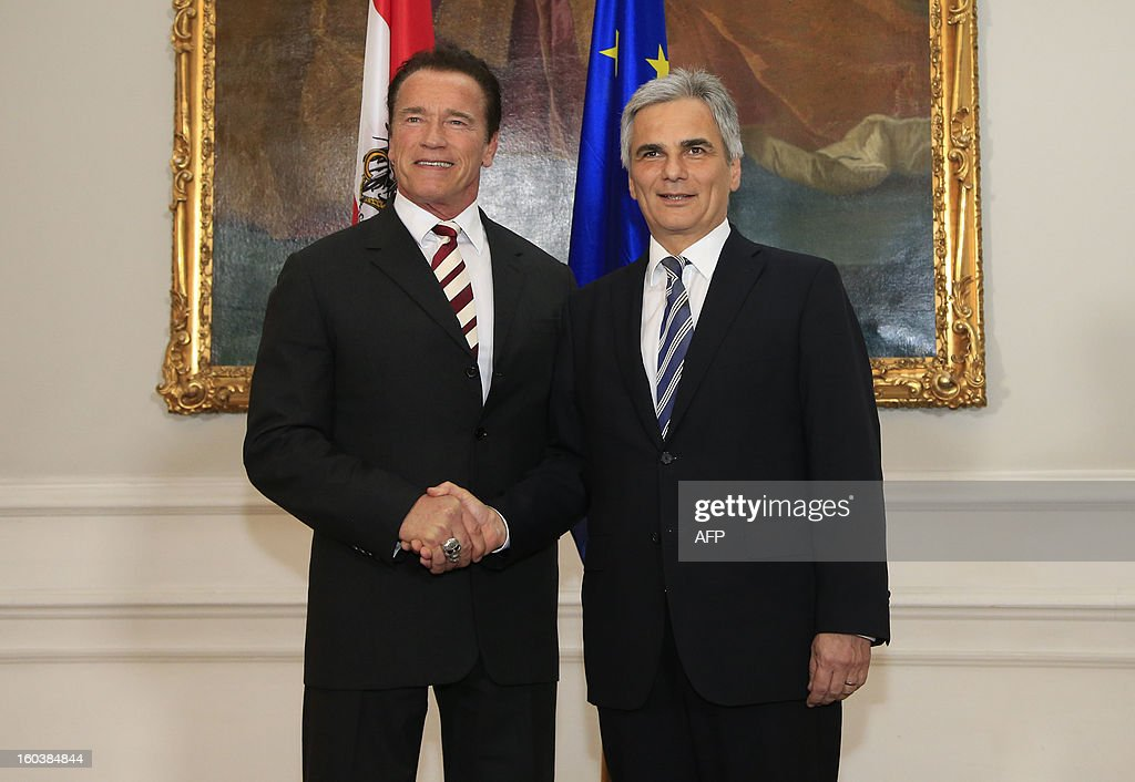 Austrian Chancellor Werner Faymann (R) shakes hands with Austrian born actor and former governor of the state of California Arnold Schwarzenegger, in Vienna on January 30, 2013.
