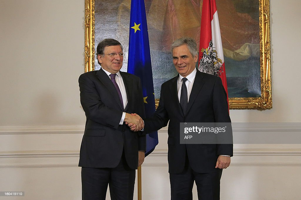 Austrian Chancellor Werner Faymann (R) shakes hands with European Commission President Jose Manuel Barroso (L) during his visit to Vienna, Austria on January 31, 2013. Barroso is also scheduled to speak at Arnold Schwarzenegger's environmental movement R20 holds its first conference.