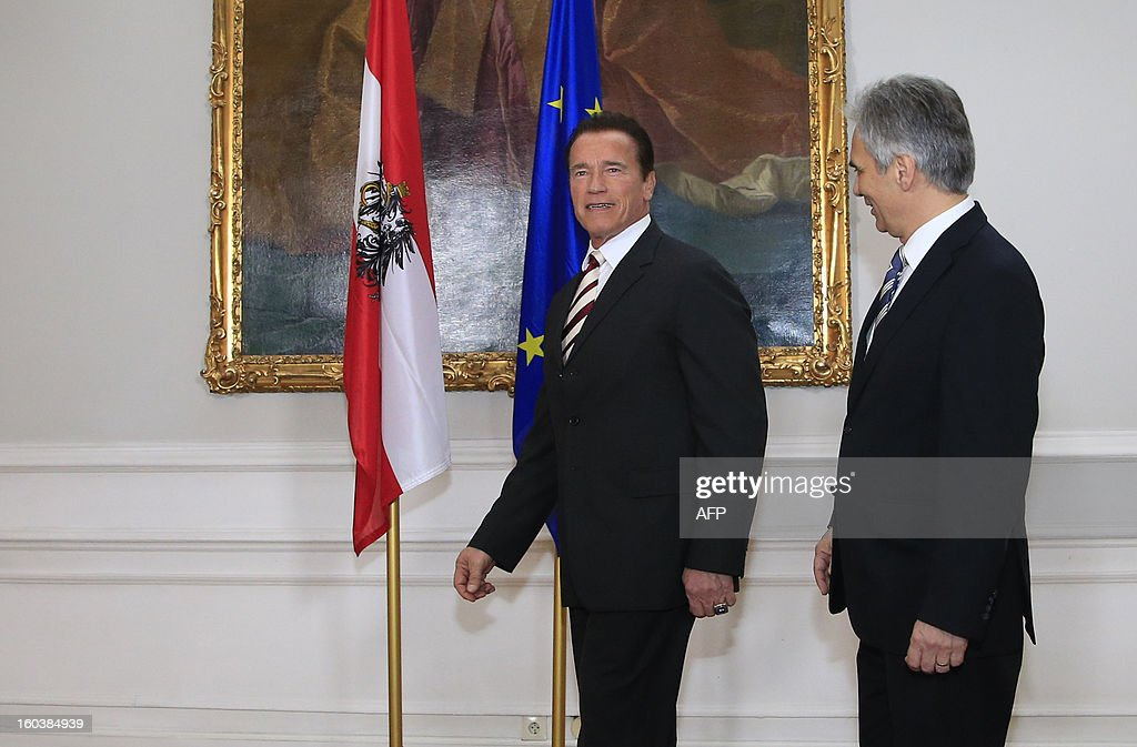 Austrian Chancellor Werner Faymann (R) welcomes Austrian born actor and former governor of the state of California Arnold Schwarzenegger, in Vienna on January 30, 2013.