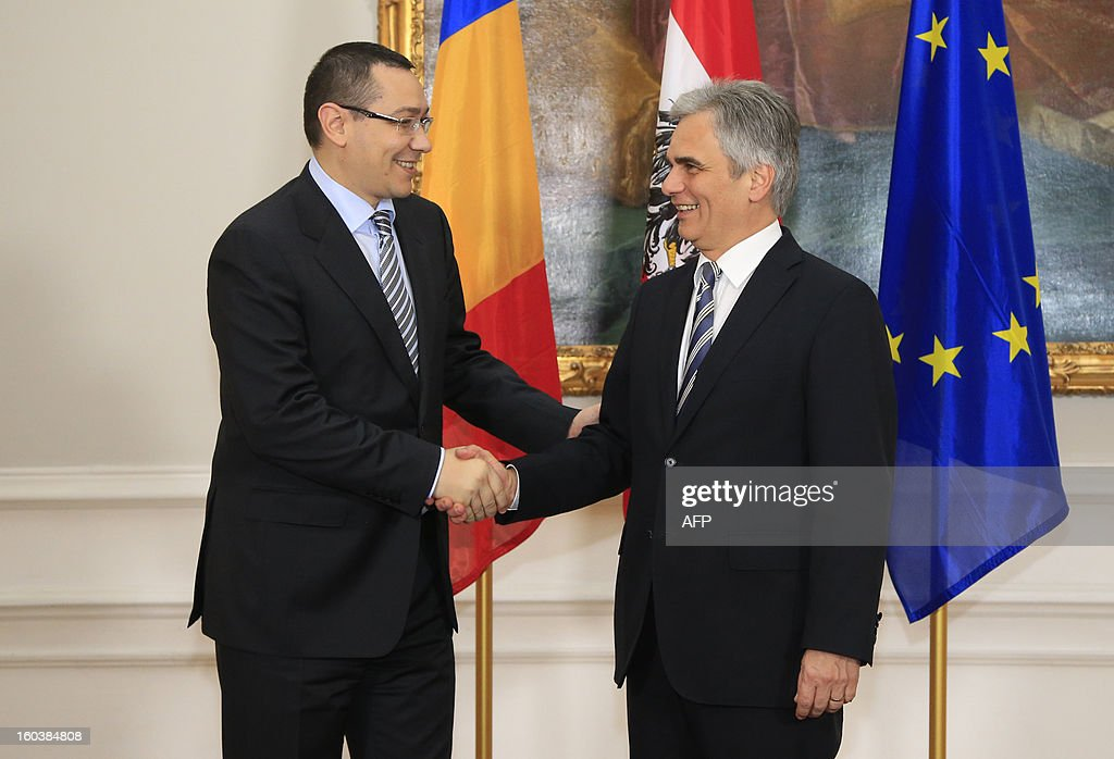 Austrian Chancellor Werner Faymann (R) welcomes Romanian Prime Minister Victor Ponta during his visit in Vienna on January 30, 2013.