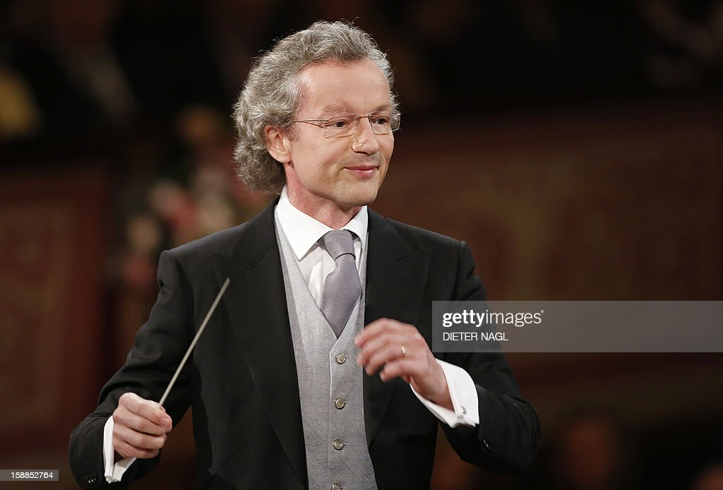 Austrian conducter Franz Welser-Moest and the Vienna Philharmonic Orchestra perform the traditional New Years Concert on January 1, 2013 at the music association in Vienna, Austria.