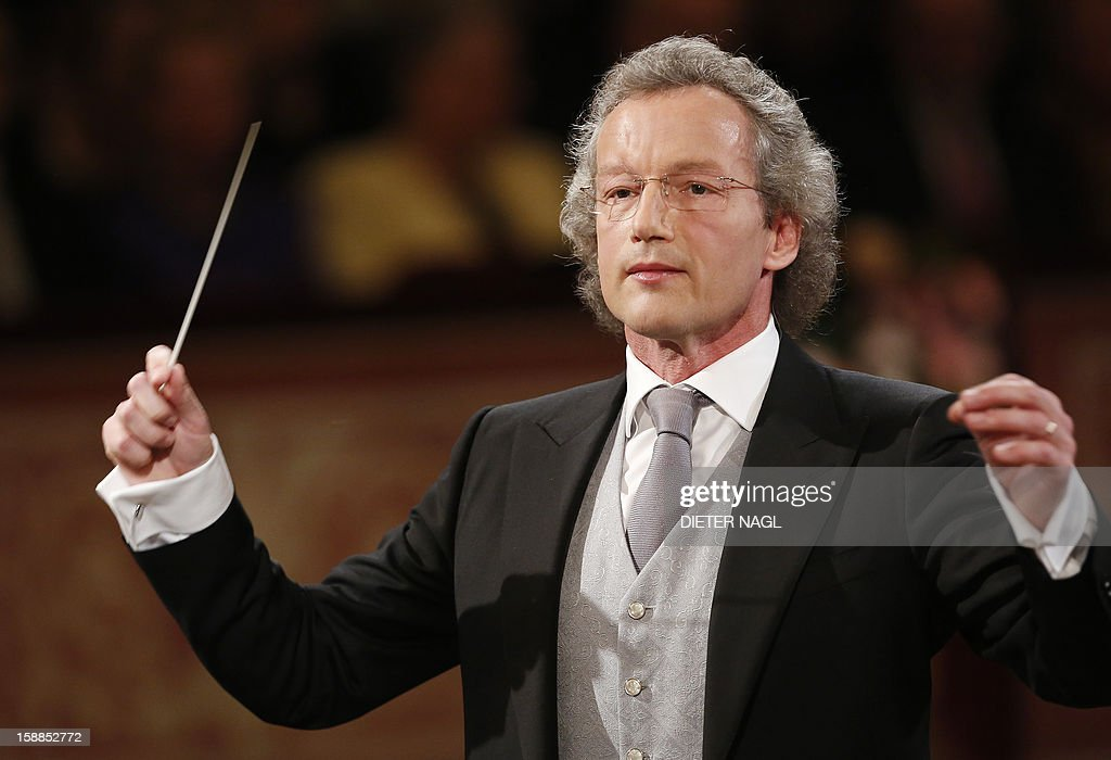 Austrian conducter Franz Welser-Moest and the Vienna Philharmonic Orchestra perform the traditional New Years Concert on January 1, 2013 at the music association in Vienna, Austria. AFP PHOTO/DIETER NAGL