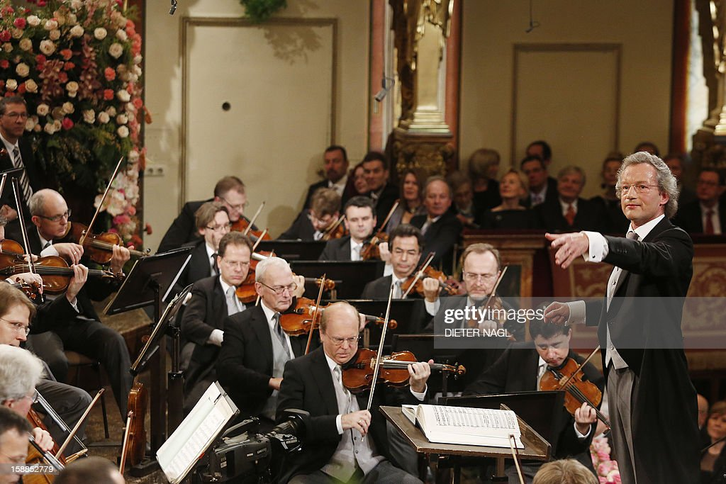 Austrian conducter Franz Welser-Moest (R) and the Vienna Philharmonic Orchestra perform the traditional New Years Concert on January 1, 2013 at the music association in Vienna, Austria.