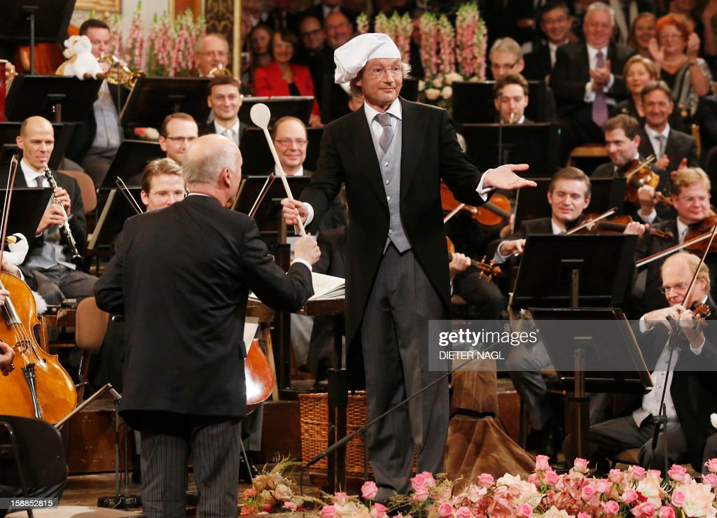 Austrian conducter Franz Welser-Moest (C) and the Vienna Philharmonic Orchestra perform the traditional New Years Concert on January 1, 2013 at the music association in Vienna, Austria.