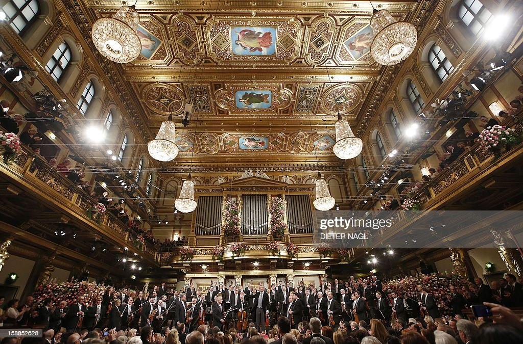 Austrian conductor Franz Welser-Moest and the Vienna Philharmonic Orchestra attend the New Year's Concert on January 1, 2013 at the Musikverein in Vienna.