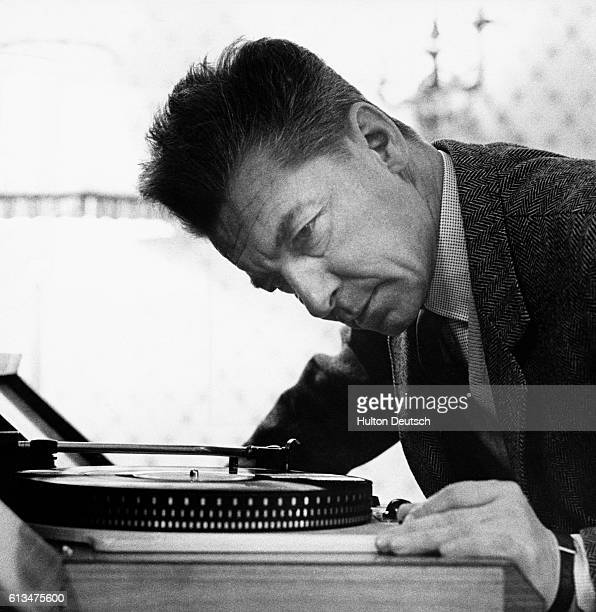 Austrian Conductor Herbert Von Karajan listening to a record