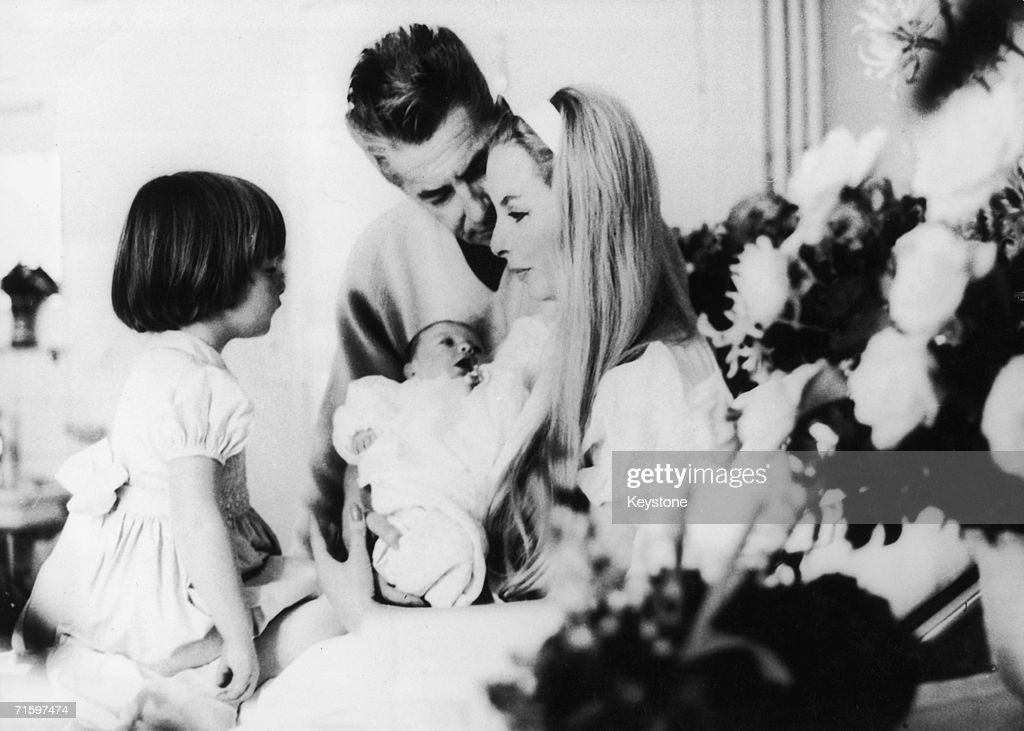 Austrian conductor Herbert von Karajan (1908 - 1989) with his wife Eliette, a former model, their three-year-old daughter Isabelle and their new baby Arabelle in St Moritz, January 1964.