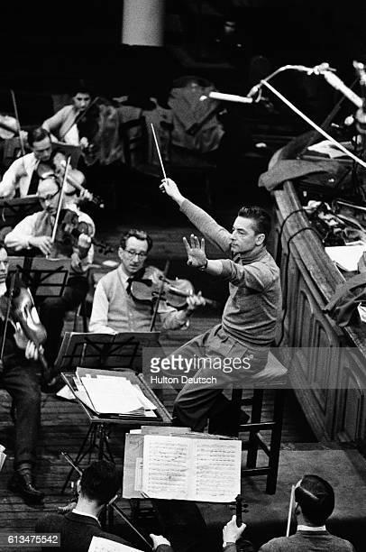 Austrian conductor stage and film director Herbert Von Karajan conducts a rehearsal