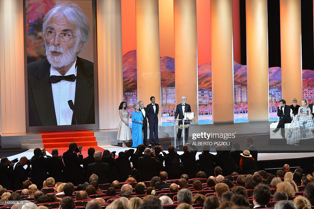 Austrian director Michael Haneke (R) delivers a speech on stage next to French actresses Audrey Tautou (L), Emmanuelle Riva (2ndL), French actor Jean-Louis Trintignant (3rdL) and US actor Adrien Brody after being awarded with the Palme d'Or for his film 'Reality' during the closing ceremony of the 65th Cannes film festival on May 27, 2012 in Cannes.