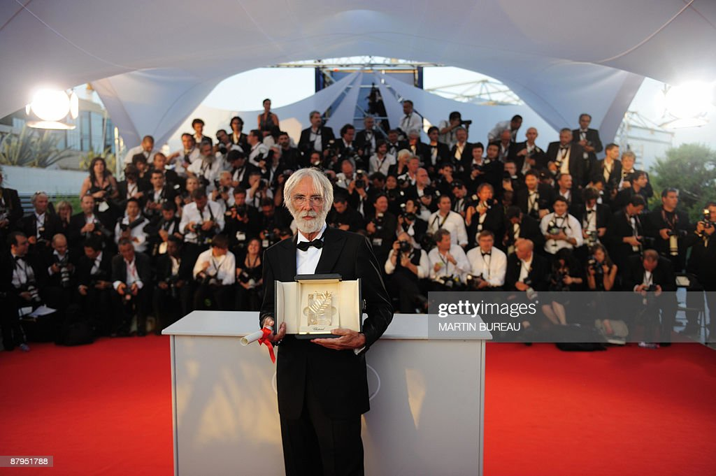 Austrian director Michael Haneke poses after being awarded with the Palme d'Or for his movie 'Das Weisse Band' (The White Ribbon), after the Closing Ceremony of the 62nd Cannes Film Festival on May 24, 2009 in Cannes, southern France.