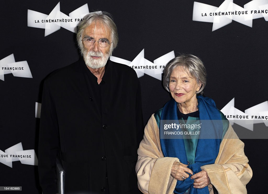 Austrian director Michael Haneke (L) poses with French actress Emmanuelle Riva during a photocall prior to the premiere screening of the movie 'Amour', awarded the 2012 Cannes film festival Palme d'Or, on October 15, 2012 in Paris.