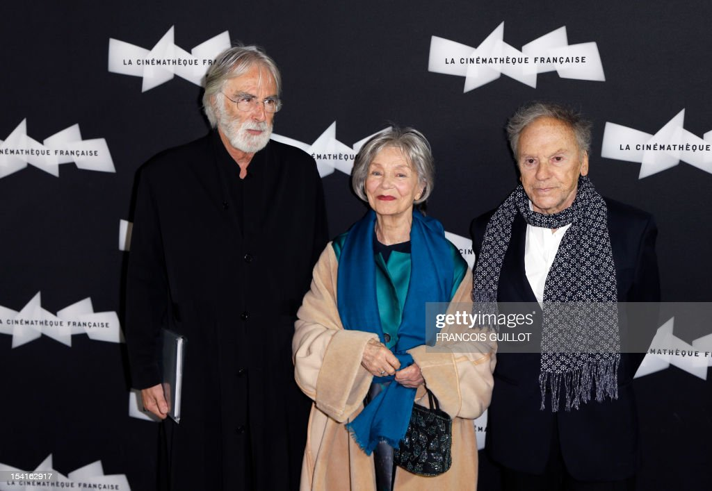Austrian director Michael Haneke (L) poses with French actress Emmanuelle Riva and French actor Jean-Louis Trintignant during a photocall prior to the premiere screening of the movie 'Amour', awarded the 2012 Cannes film festival Palme d'Or, on October 15, 2012 in Paris.