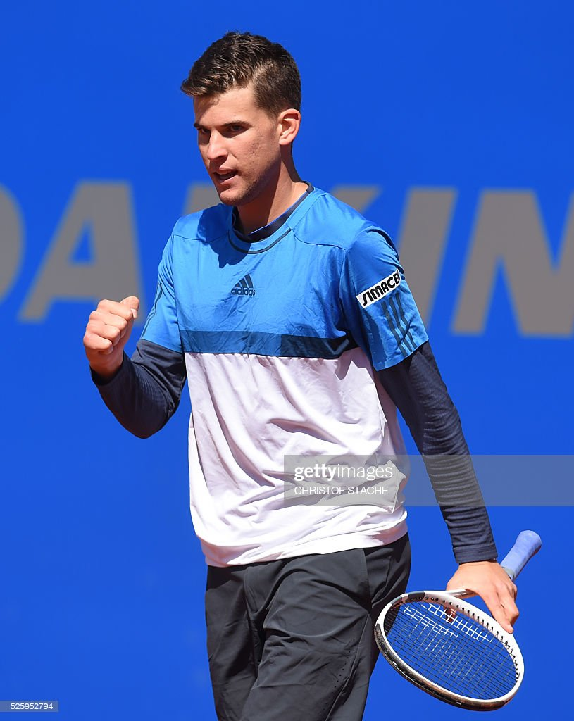 Austrian Dominic Thiem reacts during his quarter final match against Croatian Ivan Dodig at the ATP tennis BMW Open in Munich, southern Germany, on April 29, 2016. / AFP / CHRISTOF