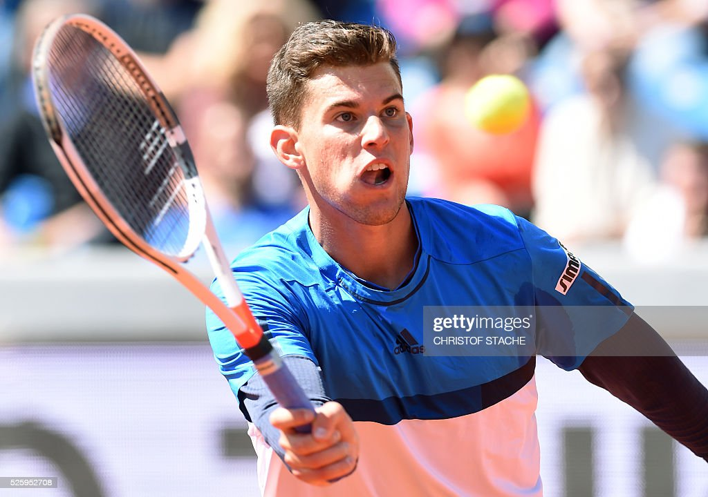 Austrian Dominic Thiem returns the ball during his quarter final match against Croatian Ivan Dodig at the ATP tennis BMW Open in Munich, southern Germany, on April 29, 2016. / AFP / CHRISTOF