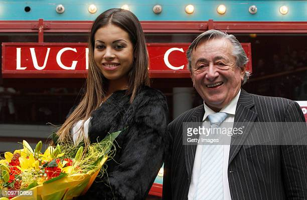 Austrian entrepreneur Richard Lugner and Moroccanborn pole dancer Karima El Mahroug nicknamed 'Ruby the Heart Stealer' pose after a press conference...