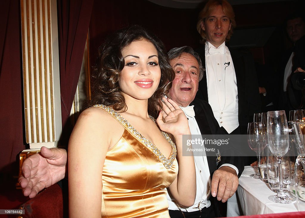 Austrian entrepreneur Richard Lugner and Moroccanborn pole dancer Karima El Mahroug nicknamed 'Ruby the Heart Stealer' attend the traditional Vienna...