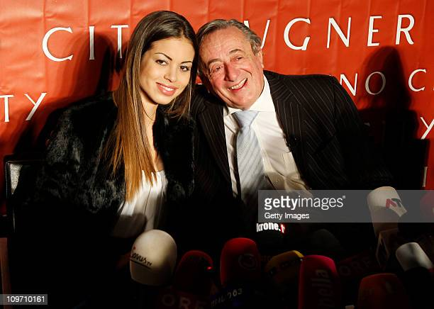 Austrian entrepreneur Richard Lugner poses with Moroccanborn pole dancer Karima El Mahroug nicknamed 'Ruby the Heart Stealer' during a press...