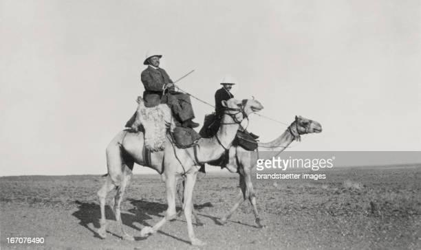 Austrian explorer Rudolf Karl Slatin and the former President of the United States Theodore Roosevelt ride on camels Khartum Sudan 15 3 1910...