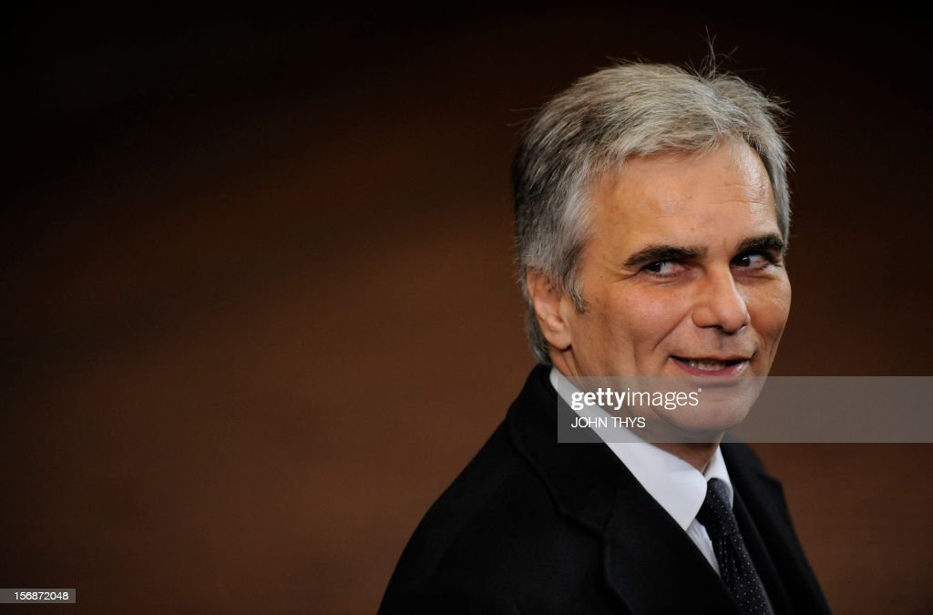 Austrian Federal Chancellor <a gi-track='captionPersonalityLinkClicked' href=/galleries/search?phrase=Werner+Faymann&family=editorial&specificpeople=4101130 ng-click='$event.stopPropagation()'>Werner Faymann</a> leaves the EU Headquarters on November 23, 2012 in Brussels, during a two-day European Union leaders summit called to agree a hotly-contested trillion-euro budget through 2020. European Union officials were scrambling to find an all but impossible compromise on the 2014-2020 budget that could successfully move richer nations looking for cutbacks closer to poorer ones who look to Brussels to prop up hard-hit industries and regions.
