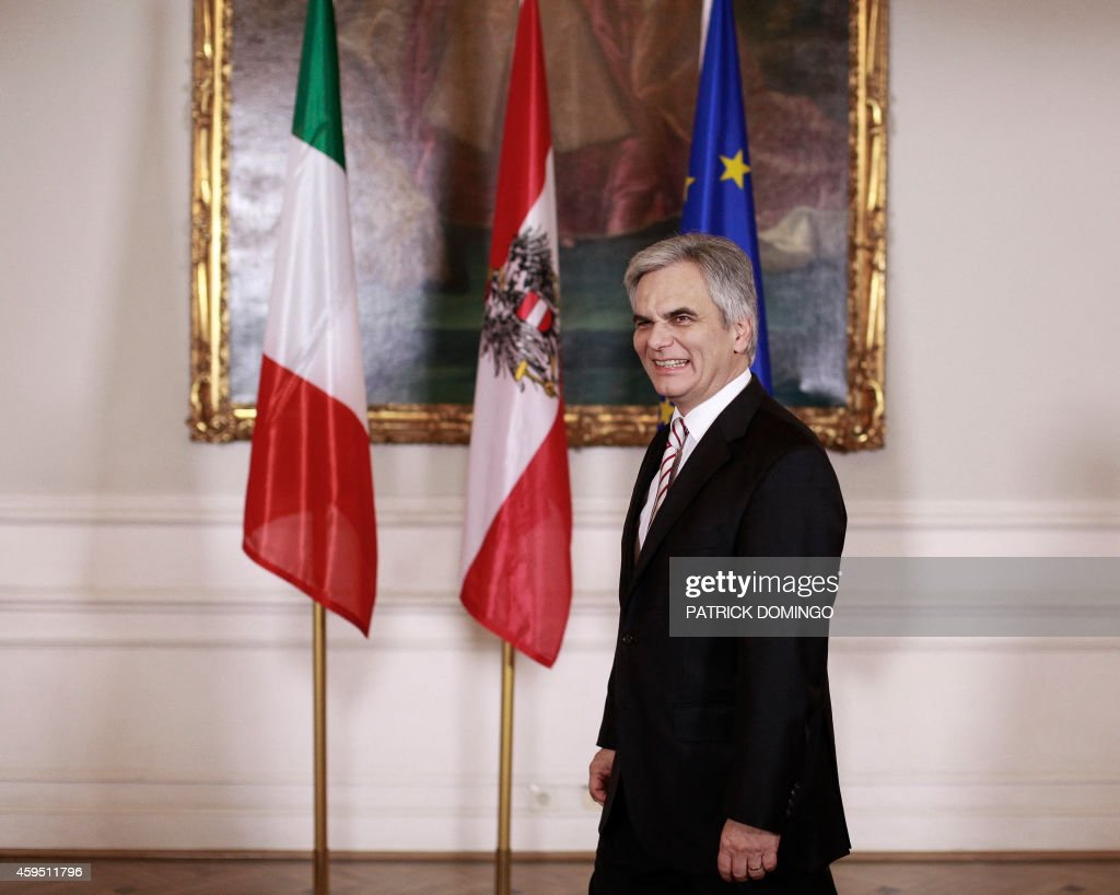 Austrian Federal Chancellor <a gi-track='captionPersonalityLinkClicked' href=/galleries/search?phrase=Werner+Faymann&family=editorial&specificpeople=4101130 ng-click='$event.stopPropagation()'>Werner Faymann</a> smiles as he waits for his guest, the Italian Prime Minister, during their meeting on November 24, 2014 in Vienna.