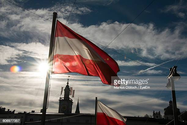 Austrian Flag Against Government Building And Sky