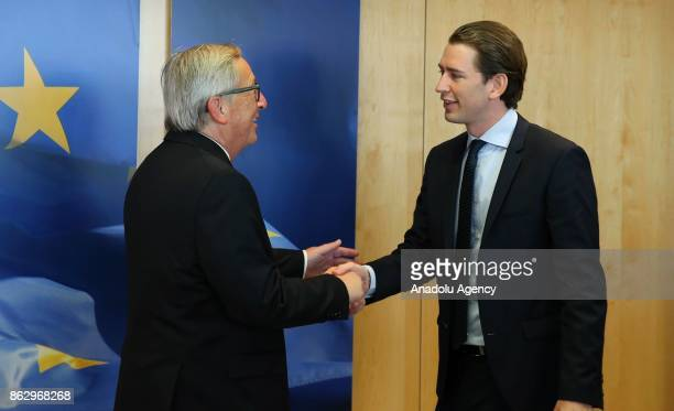 Austrian Foreign Minister and Chairman of the Austrian People's Party Sebastian Kurz and European Commission President JeanClaude Juncker shake hands...