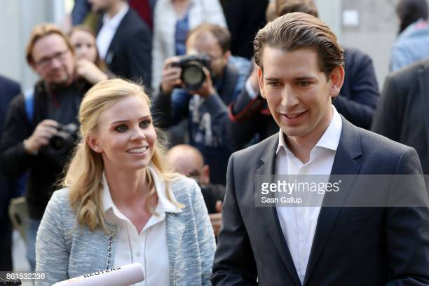 Austrian Foreign Minister and leader of the conservative Austrian People's Party Sebastian Kurz and his girlfriend Susanne Thier speak to media as...