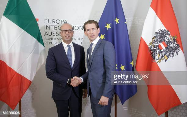 Austrian Foreign Minister Sebastian Kurz and Italian Foreign Minister Angelino Alfano shake hands during a meeting in Vienna Austria on July 20 2017...