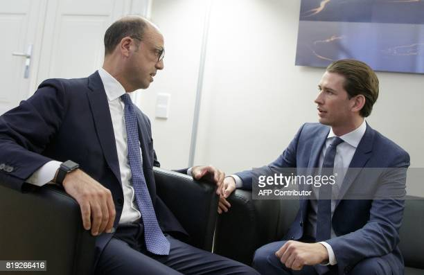 Austrian Foreign Minister Sebastian Kurz and Italian Foreign Minister Angelino Alfano talk during a meeting in Vienna Austria on July 20 2017 / AFP...