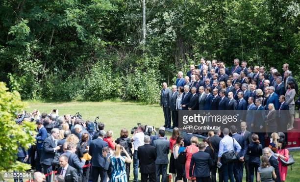 Austrian Foreign Minister Sebastian Kurz and Russian Minister of Foreign Affairs Sergei Lavrov pose for a family photo with other participants of the...