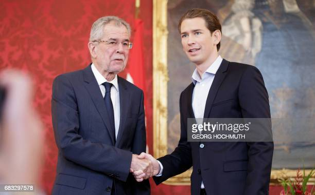 Austrian Foreign Minister Sebastian Kurz designated head of the Austrian People's Party shakes hands with Austrian President Alexander Van der Bellen...