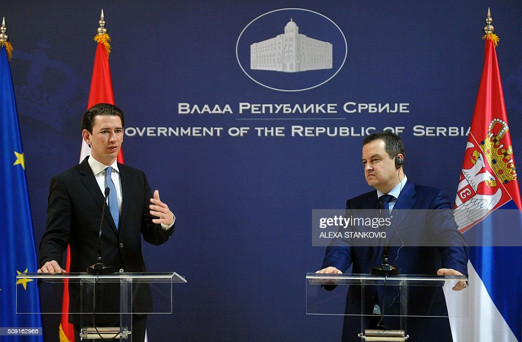 Austrian Foreign Minister Sebastian Kurz (L) gestures as he delivers a speech during a joint news conference with his Serbian counterpart Ivica Dacic (R) after their meeting in Belgrade on February 9, 2016. STANKOVIC / Serbia OUT