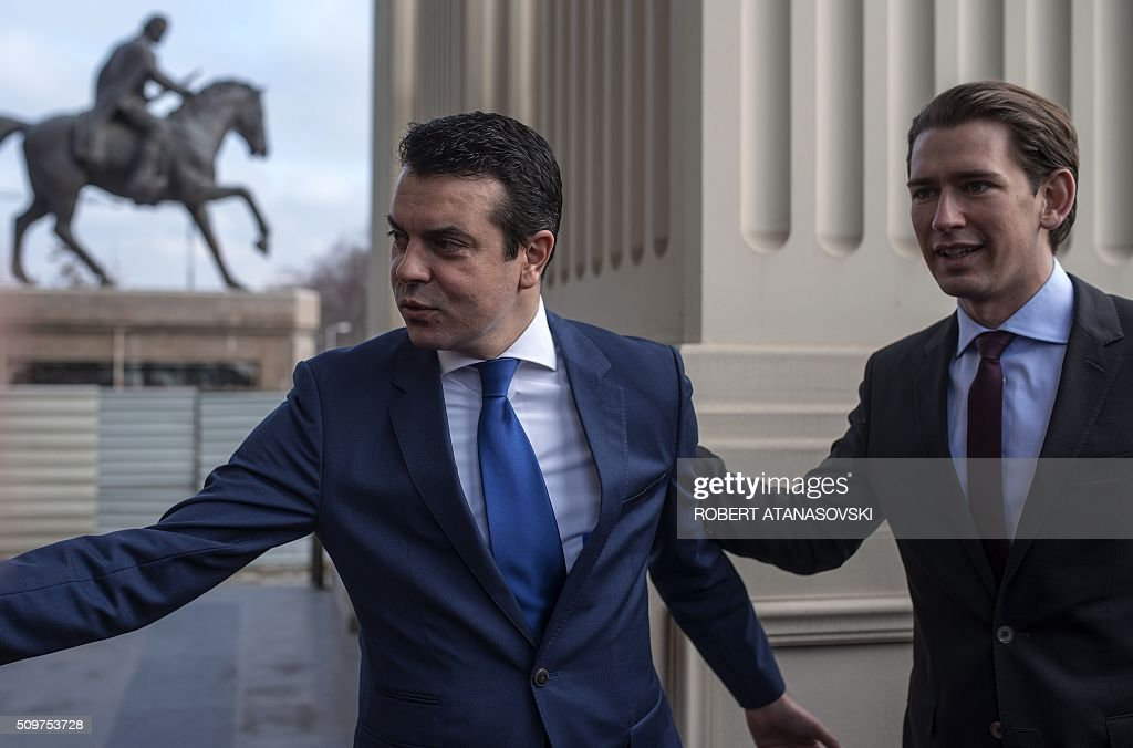 Austrian Foreign Minister Sebastian Kurz (R) is welcomed by Macedonian Foreign Minister Nikola Popovski for a meeting in Skopje on February 12, 2016. / AFP / Robert ATANASOVSKI