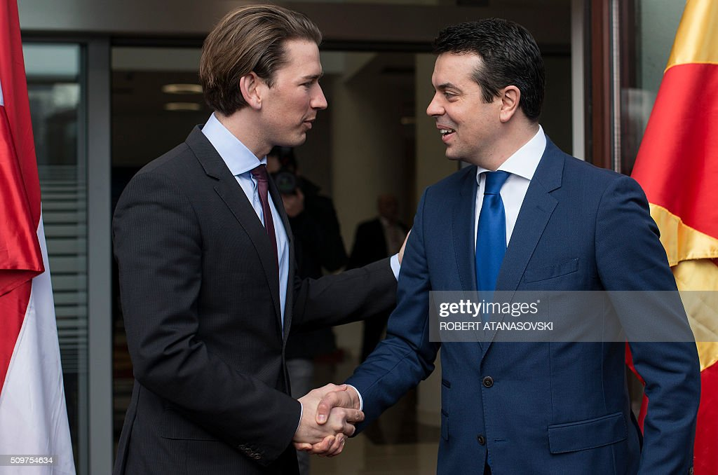 Austrian Foreign Minister Sebastian Kurz (L) is welcomed by Macedonian Foreign Minister Nikola Popovski for a meeting in Skopje on February 12, 2016. / AFP / Robert ATANASOVSKI