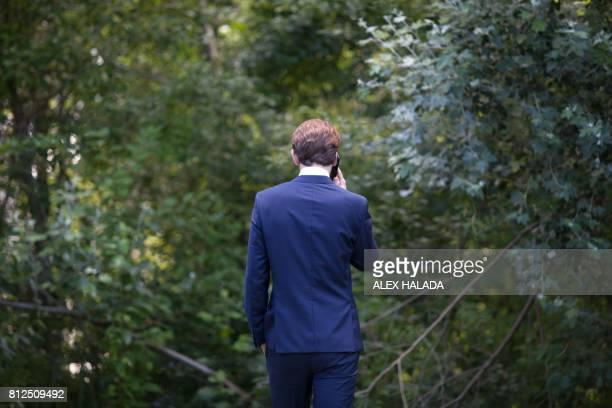 Austrian Foreign Minister Sebastian Kurz phones during the OSCEmeeting 'Building Trust through Dialogue and Cooperation' in Mauerbach Austria on July...