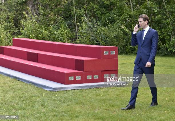 Austrian Foreign Minister Sebastian Kurz takes a phone call during the OSCEmeeting 'Building Trust through Dialogue and Cooperation' in Mauerbach...