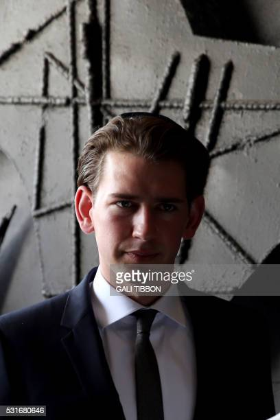 Austrian Foreign Minister Sebastian Kurz wears a kippa the traditional Jewish skullcap for men on May 16 2016 during his visit to the Yad Vashem...