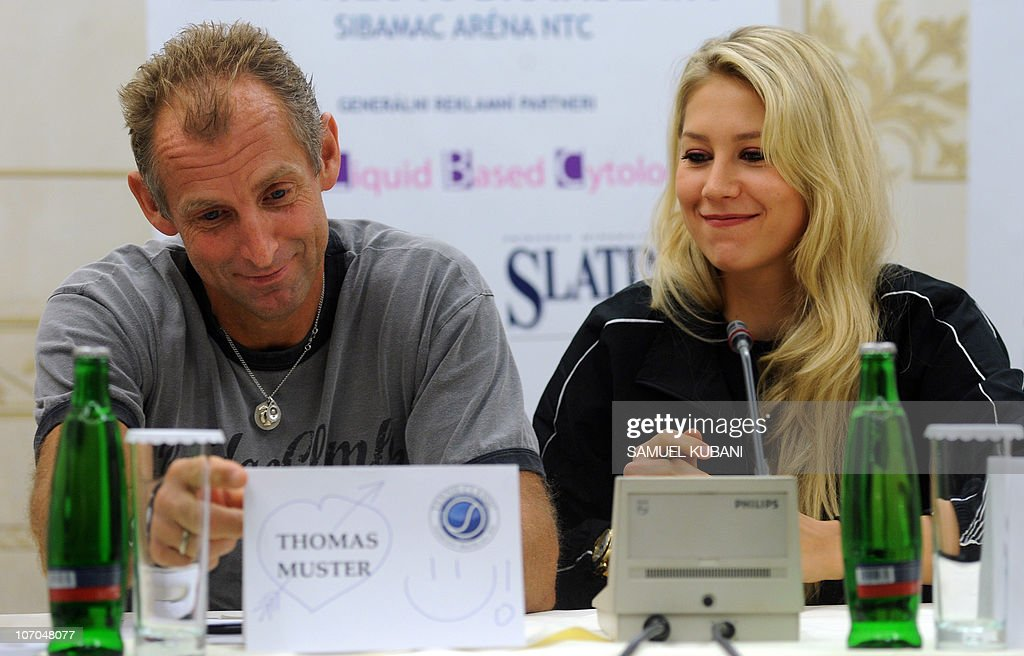 Austrian former tennis player Thomas Muster (L) jokes with Russian former tennis player Anna Kurnikova during a press conference on November 21,2010 in Bratislava. Muster and Kurnikova will play a charity exhibition match against Slovak players Dominik Hrbaty and Dominika Cibulkova in Bratislava's tennis arena on November 22.