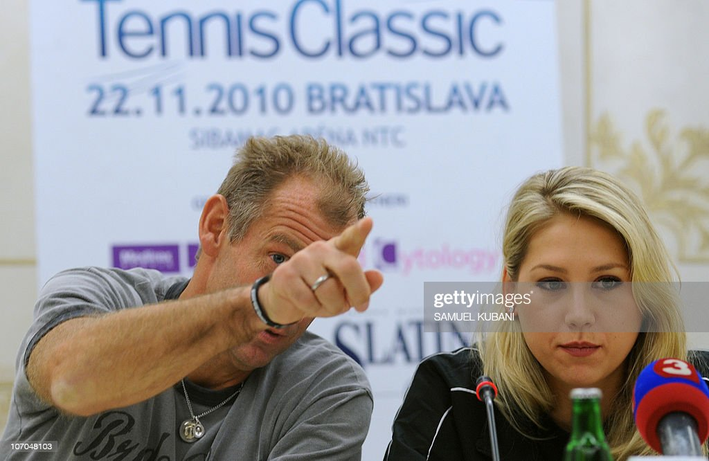 Austrian former tennis player Thomas Muster (L) jokes with Russian former tennis player Anna Kurnikova during a press conference on November 21,2010 in Bratislava. Muster and Kurnikova will play a charity exhibition match against Slovak players Dominik Hrbaty and Dominika Cibulkova in Bratislava's tennis arena on November 22. AFP PHOTO/SAMUEL KUBANI