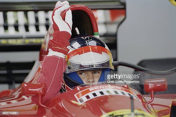 Austrian Formula One racing driver Gerhard Berger pictured in the driver's seat of the Scuderia Ferrari 412T1 V12 prior to competing to finish in...