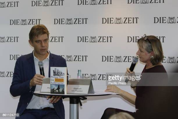 FRANKFURT FRANKFURT HESSE GERMANY Austrian historian Philipp Ther gives an interview with the journalist Elisabeth von Thadden at the booth of the...