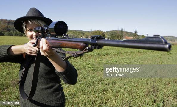 Austrian huntress Evelin Grubelnig is pictured with her Mauser bolt action rifle during a morning stalk at the Szeuizvoelgyi hunting grounds on...