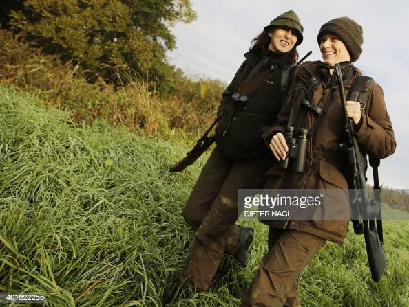 Austrian huntress Petra Schneeweiss and her daughter Elia walk during a stalk at the Szeuizvoelgyi hunting grounds on October 12 2013 near Kisbucsa...