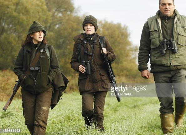 Austrian huntress Petra Schneeweiss and her daughter Elia walk with Professional Hunter Jozef during a stalk at the Szeuizvoelgyi hunting grounds on...